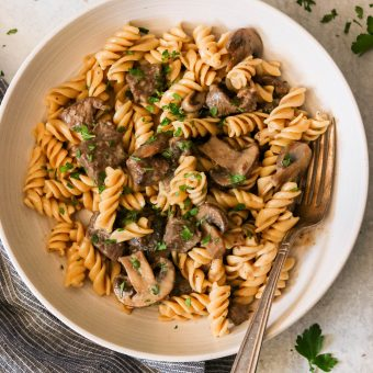 paleo beef stroganoff on a plate served with a fork