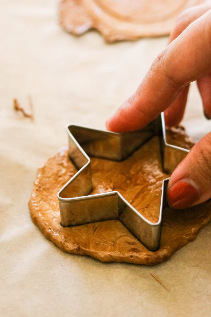 Stamping out a star shape cookie cutter to make Korean ppogi recipe