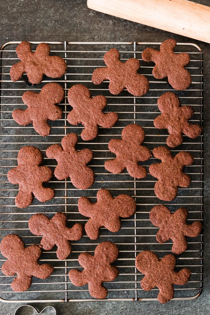 chocolate gingerbread cut out cookies cooling on the cooling rack