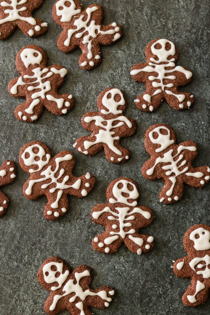 Gluten free chocolate sugar cookies cut out into skeleton gingerbread men